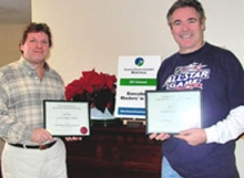 Photo of Steve & Paul with certificates following seminar