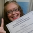 Trish happy SEO Grad Selflie with certificate