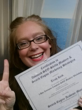 Trish happy SEO Grad Selflie with certificate